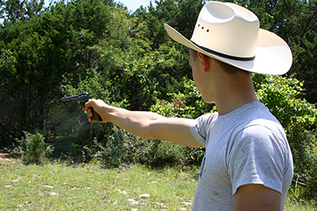 A western-style .22 and the hat to go along