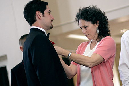 Family friend & wedding Director Mrs. Brown pinning boutonniére