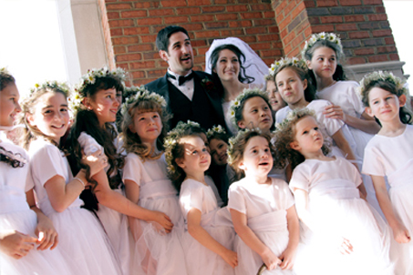 The Groom and Bride with the Flowergirl Brigade