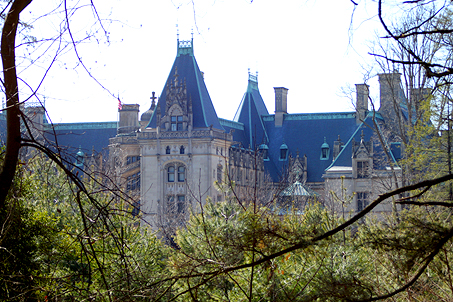 Our first glimpse of the Biltmore Estate through the trees as we round the corner