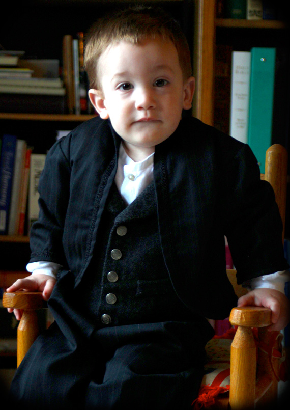 Calvin sports his new nineteenth-century attire that his Mama made
