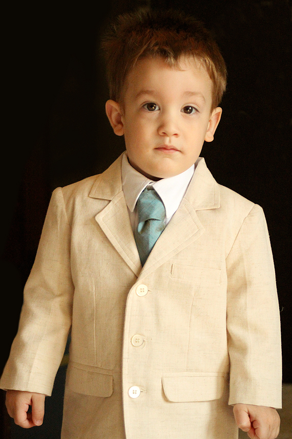 The world's cutest ring bearer gets all suited up for a pre-rehearsal rehearsal