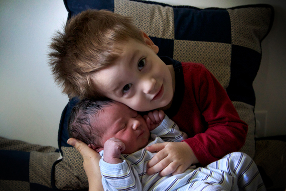 Calvin holds his long-awaited little brother