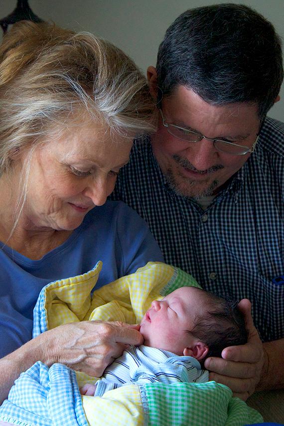 Grandpa and Grandma dote on Christian