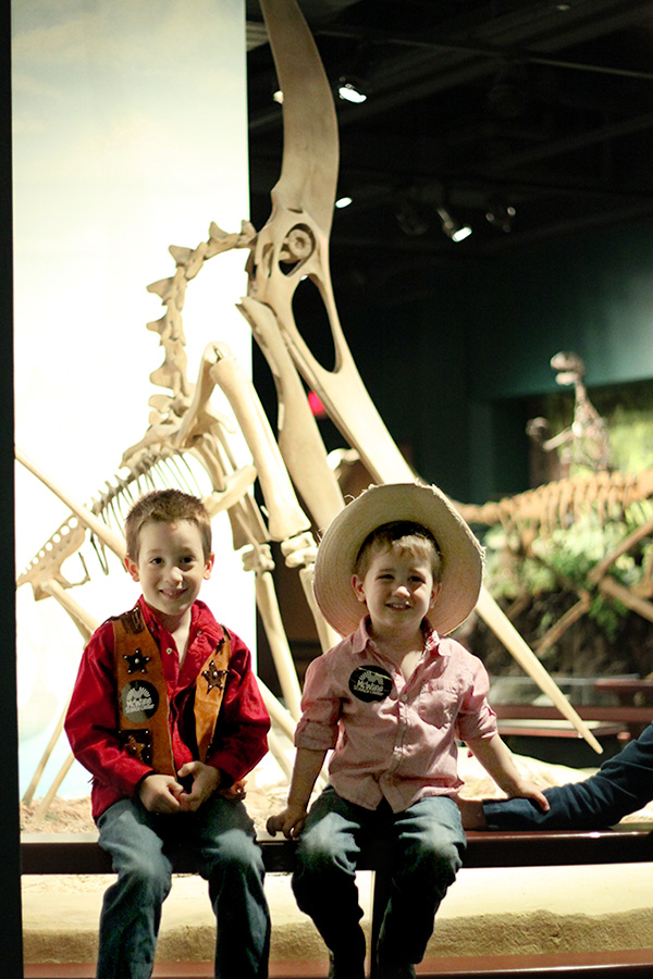 Dragons of Old — Perched in Front of a Pteranodon Skeleton
