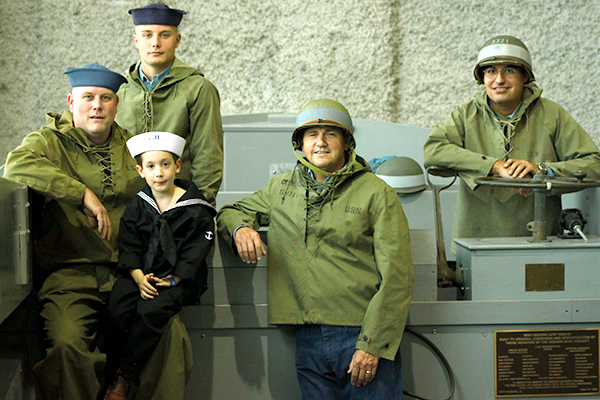 Calvin Poses with the Reenacting Crew of a Higgins Craft