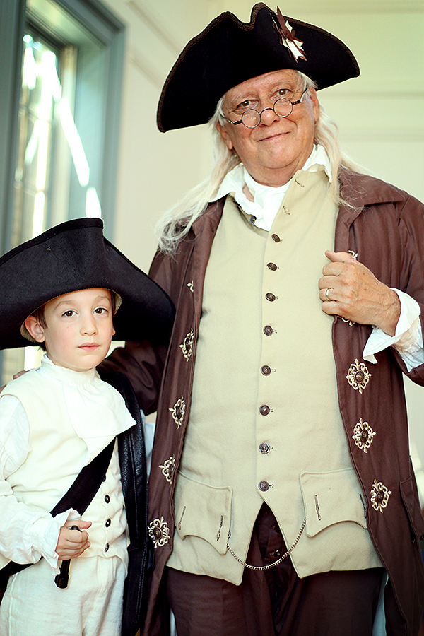 Calvin and Benjamin Franklin after his demonstration on electricity